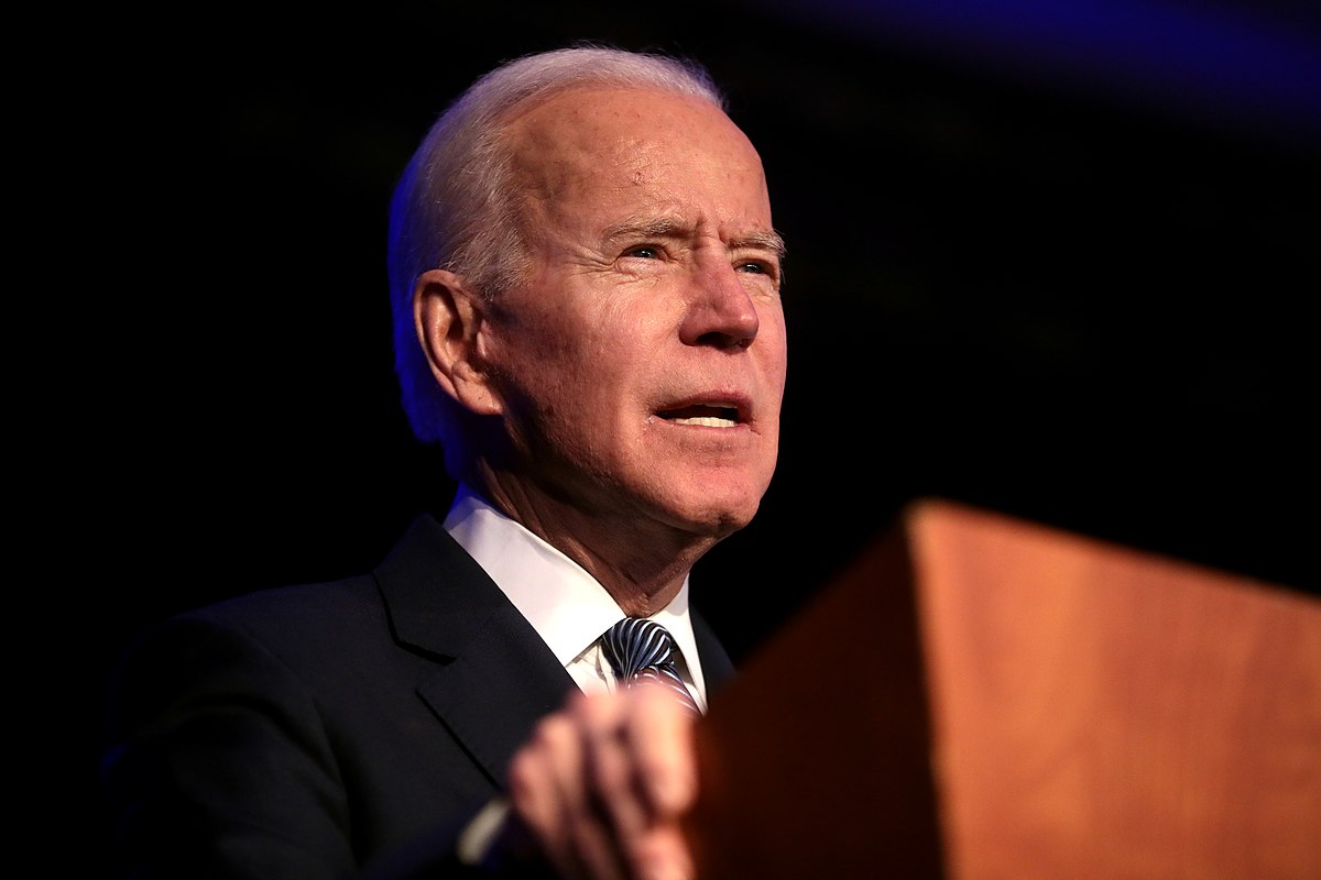President Joe Biden standing and speaking; Biden gun control