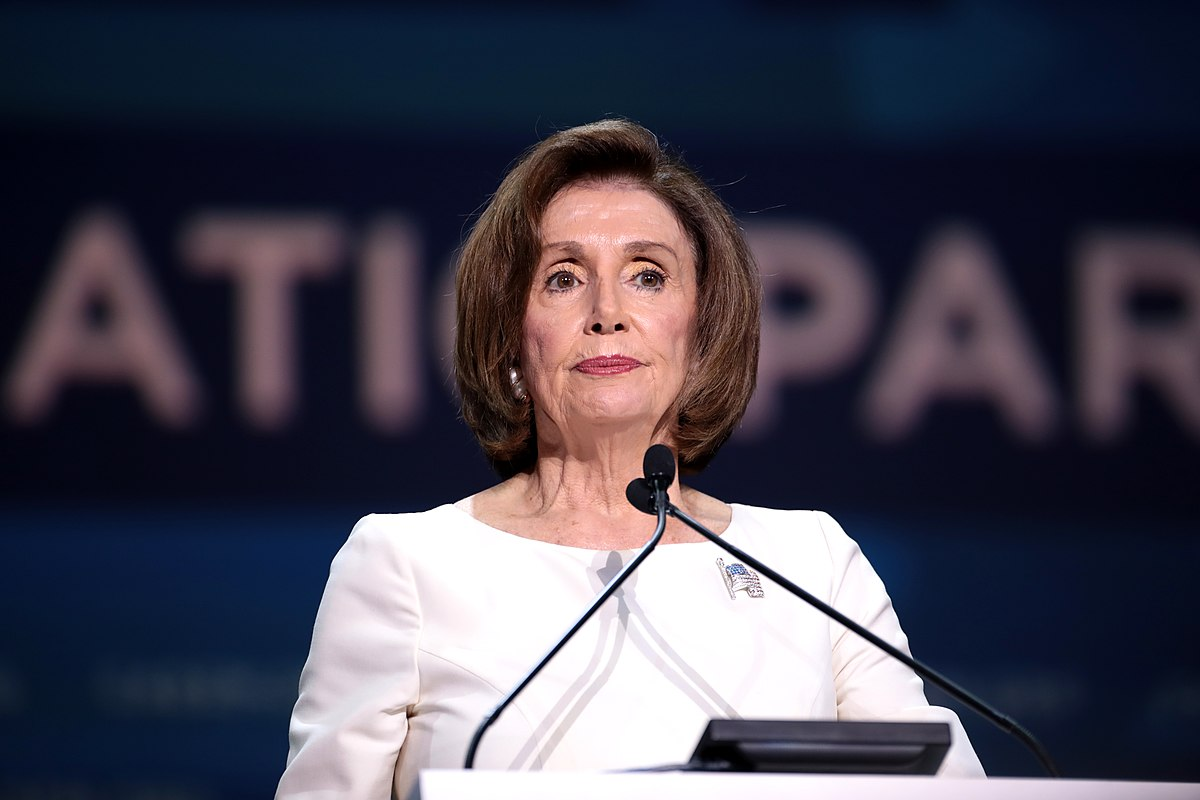 Nancy Pelosi at podium; Pelosi Trump border