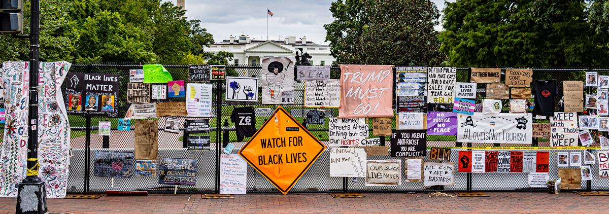 Protest signs in Washington, DC; Biden Republicans police