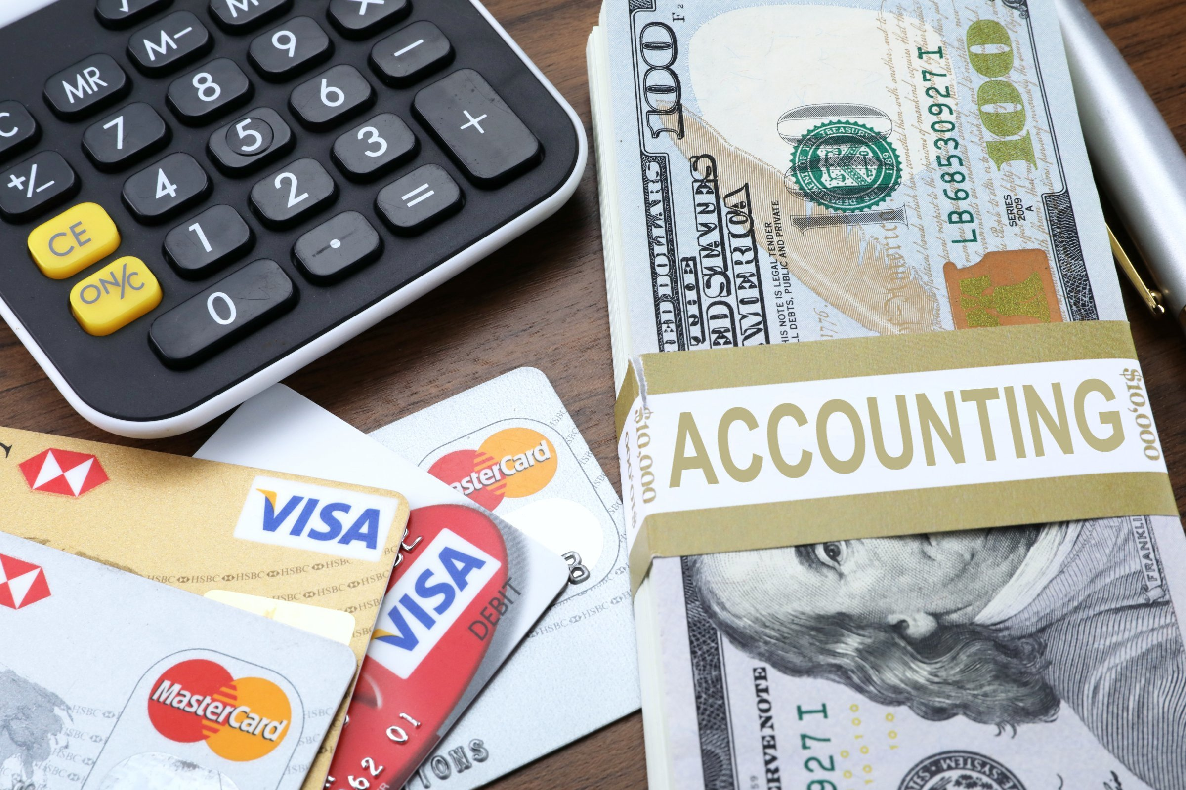Money, credit cards and a calculator; inclusive program students