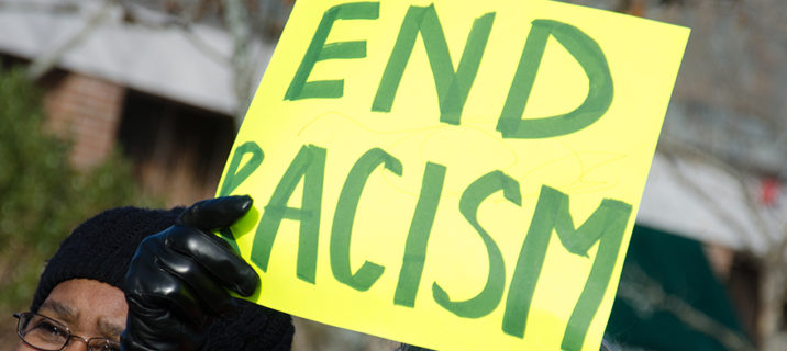 End Racism sign; federal government race training