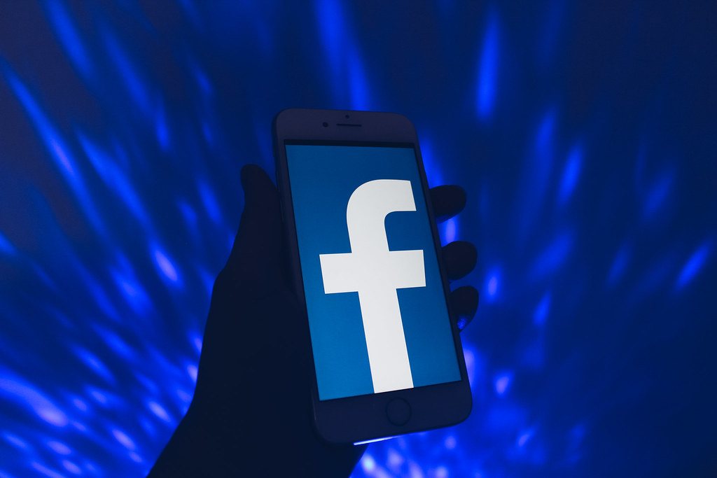 Facebook logo on phone; Facebook free speech