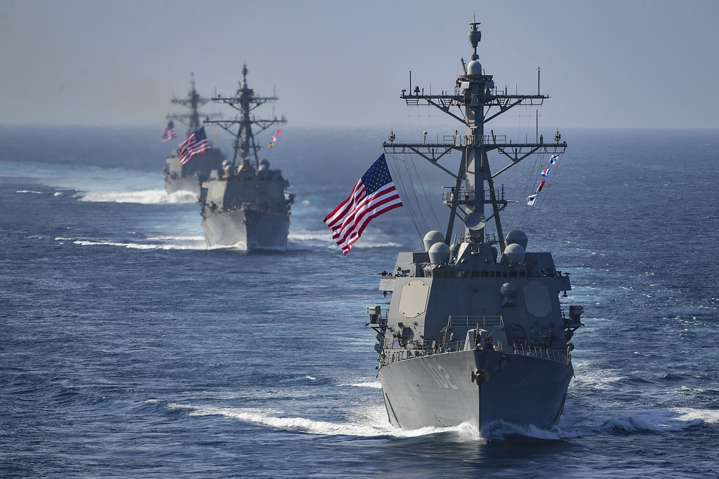 Navy ships with American flags; Navy report