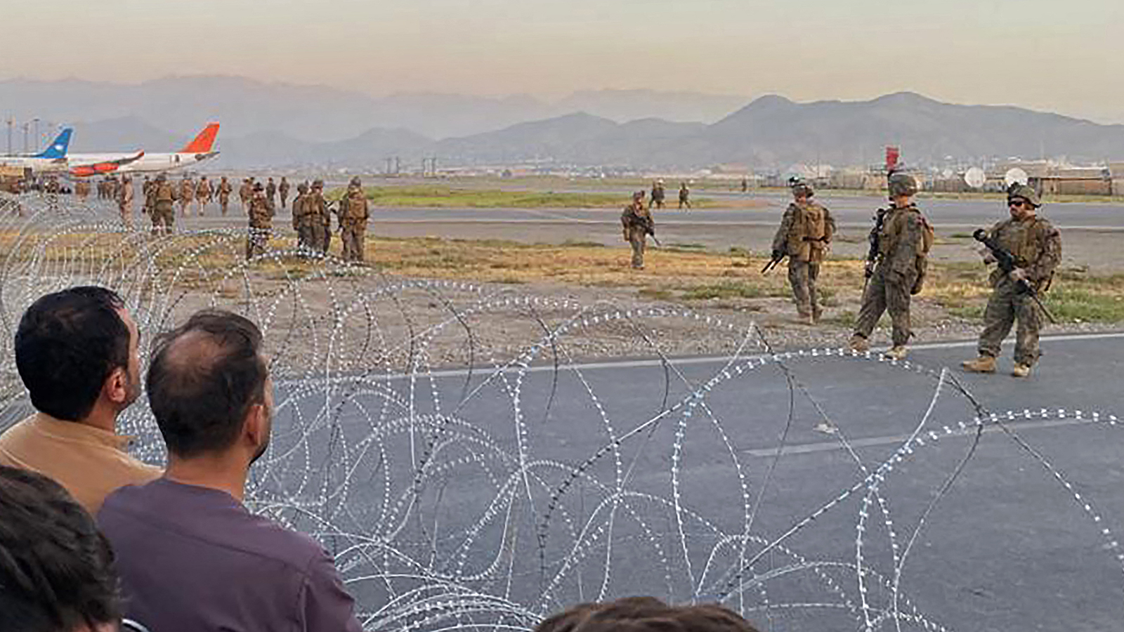 U.S. military guarding airport; Biden Afghanistan pullout