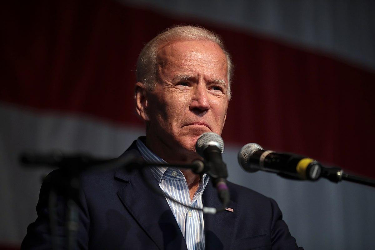 Joe Biden at microphone; poll Biden resign